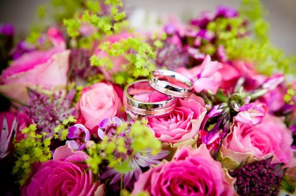 wedding ring on a bouquet of flowers