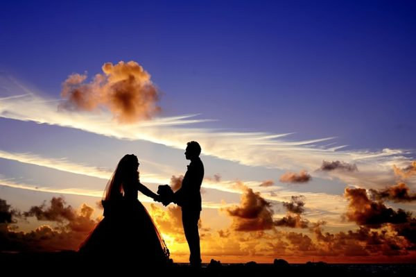 newly-wed couple during sunset