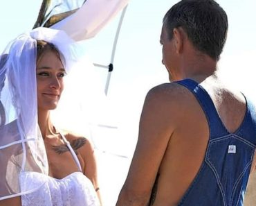 couple gets married in bikini and overalls