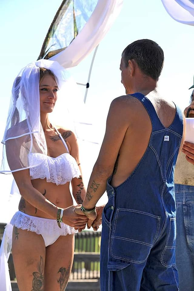 couple gets married wearing bikini and overalls