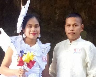 bride wears wedding gown made from paper